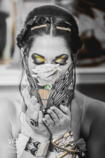 P.S. I Love You Productions - black and white photo of bride smelling flower with certain spots in color