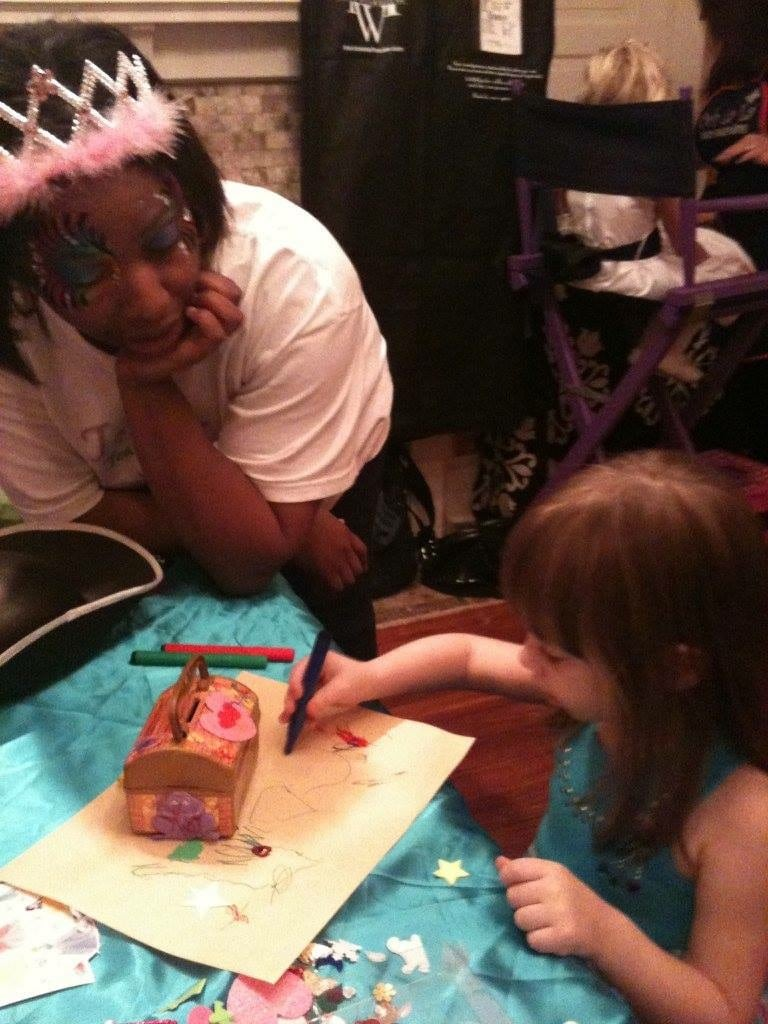 Tootles Event Sitters - adult and child coloring together