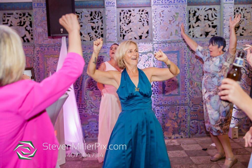 women dancing and having fun during wedding reception