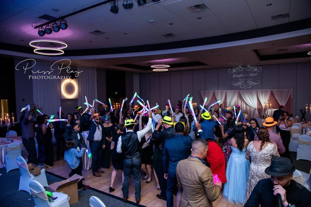 wedding guests dancing at reception with glow sticks