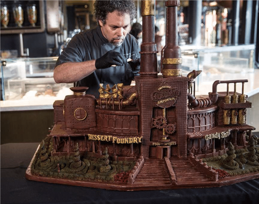 P.S. I Love You Productions, photo of artist creating a chocolate factory display