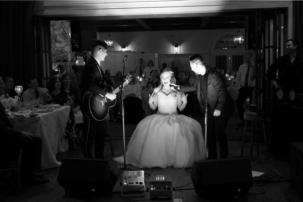 P.S. I Love You Productions, bride standing with band at microphone