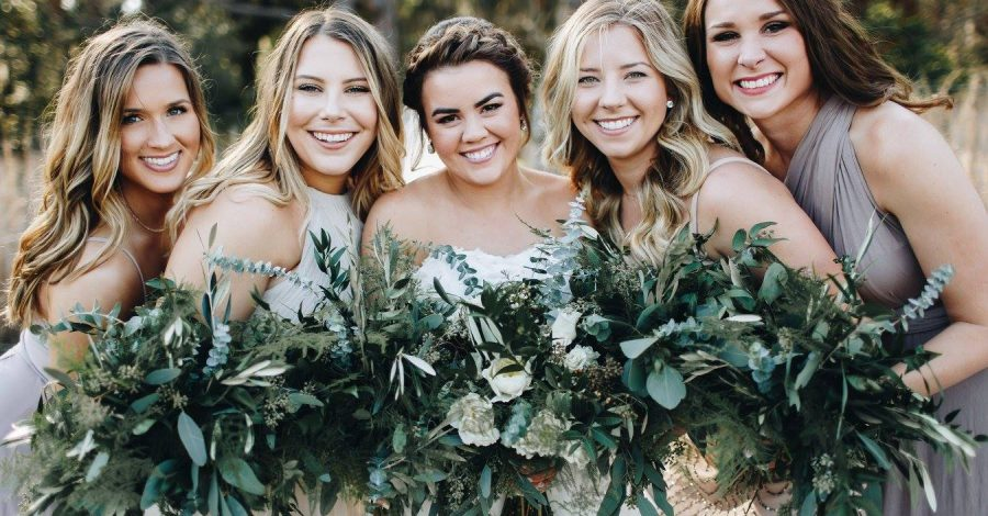 cdc-floral- bridesmaids with bride holding greenery