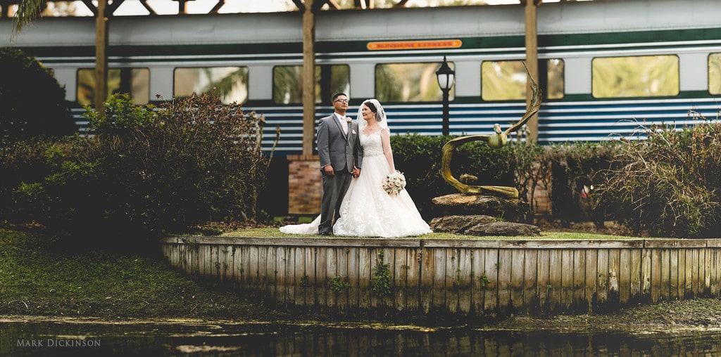 Estate on the Halifax - bride and groom in front of classic train car