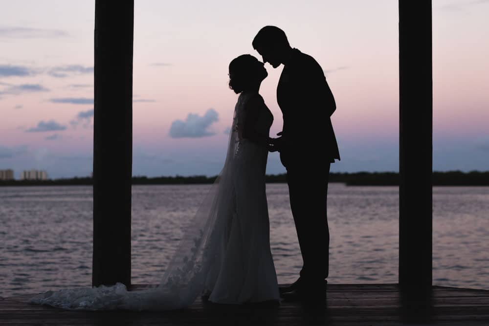 Estate on the Halifax - bride and groom silhouetted by sunset on the Halifax River