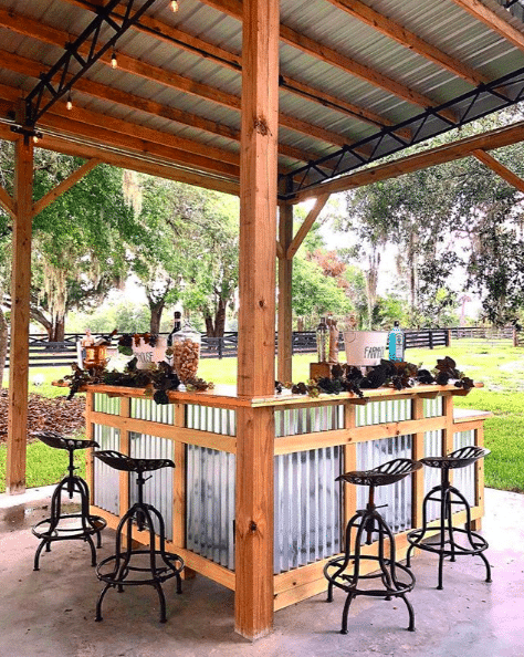 The-Farmhouse-on-44-Four stool bar under outdoor pavilion