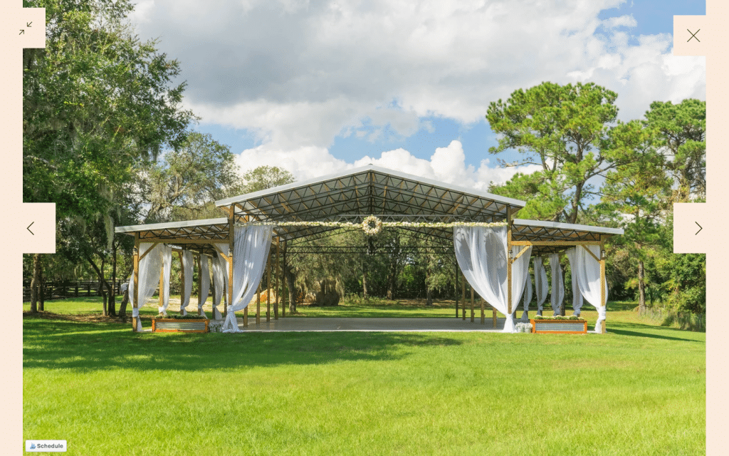 The-Farmhouse-on-44-Outdoor pavilion with white swags set up during daytime for reception