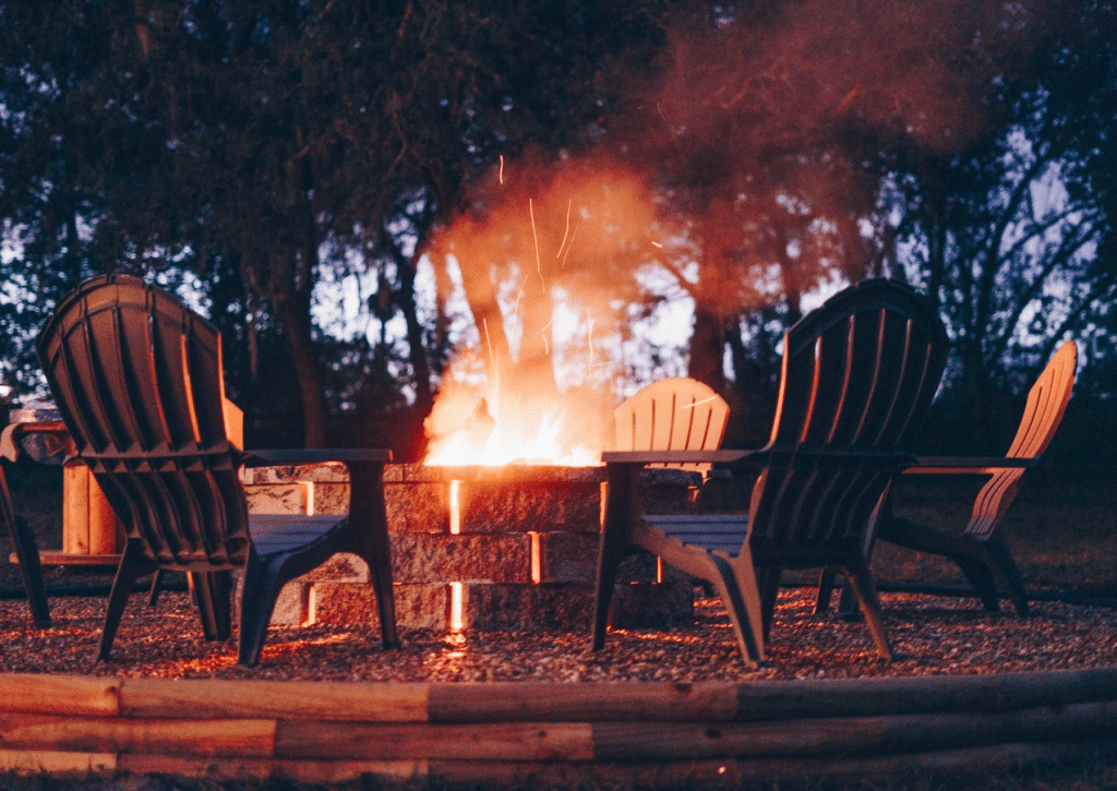 The-Farmhouse-on-44-Fire pit and chairs at dusk