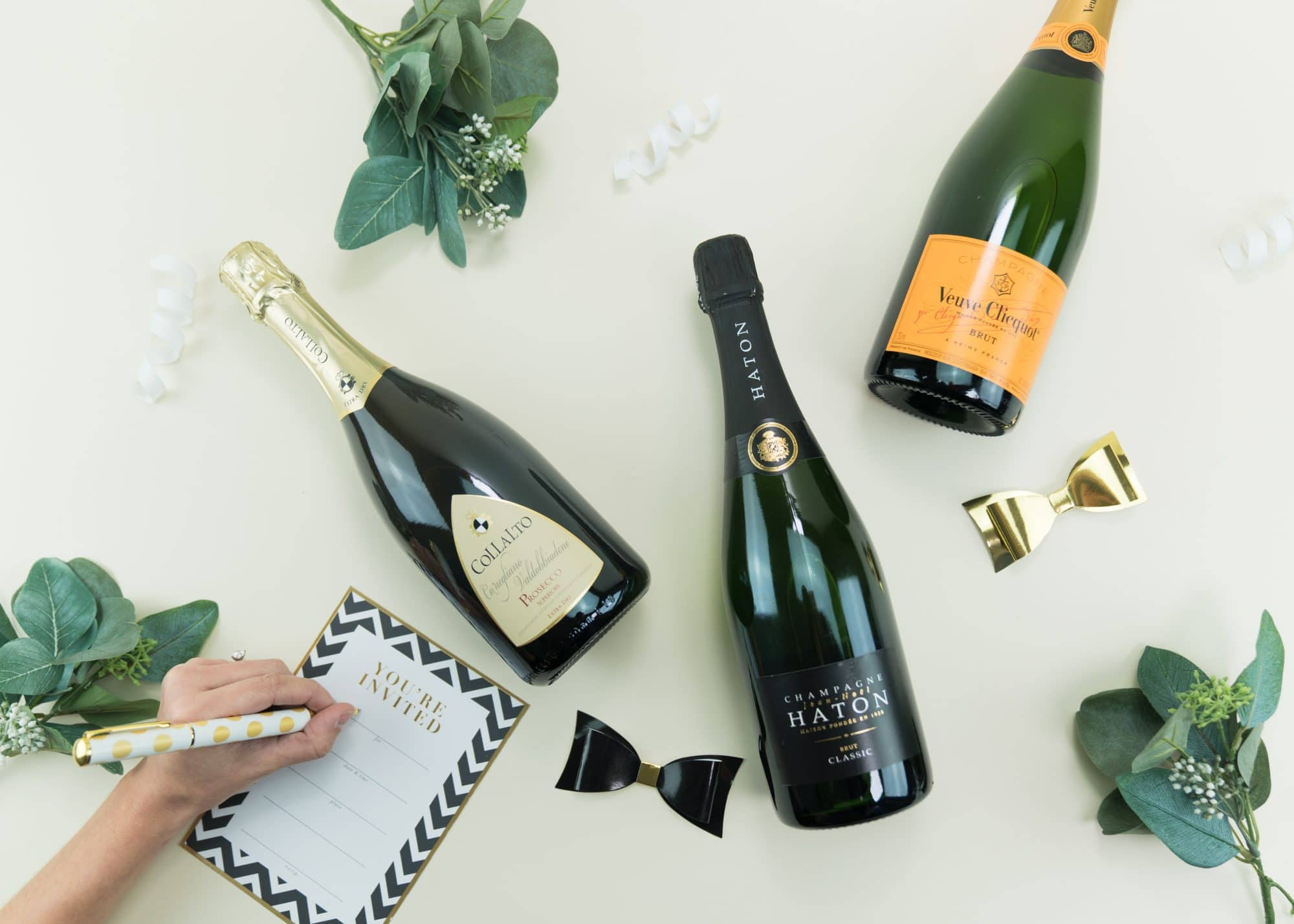 ABC Fine Wine & Spirits - flat lay photo of champagne bottles