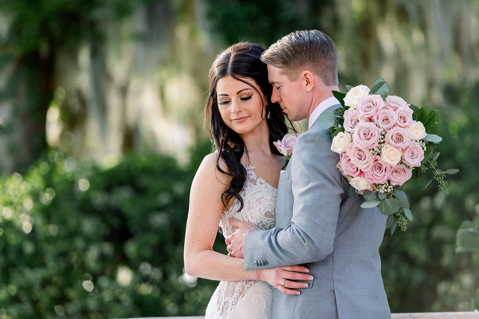 Chynna Pacheco Photography - bride and groom embracing each other large pink rose bouquet