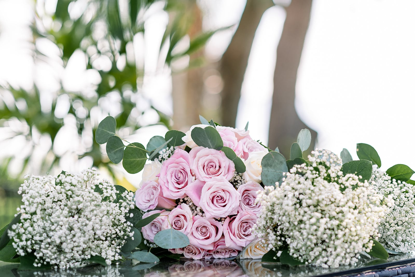 Chynna Pacheco Photography - large rose bouquet flanked by smaller baby's breath bouquets