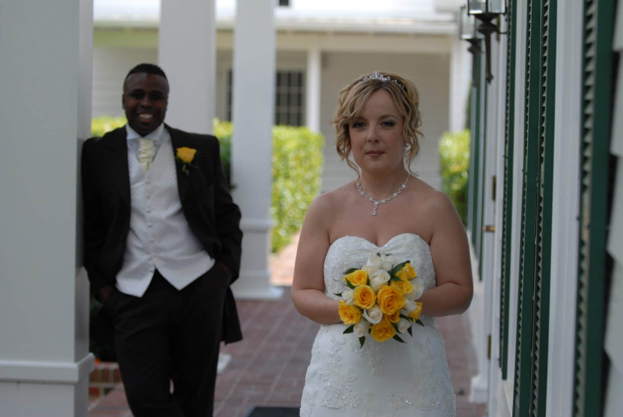 Get Married in Florida - bride under covered porch with husband in background