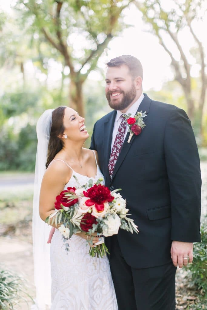 KMD Creations Photography and Film - bride and groom with stunning red and white flowers