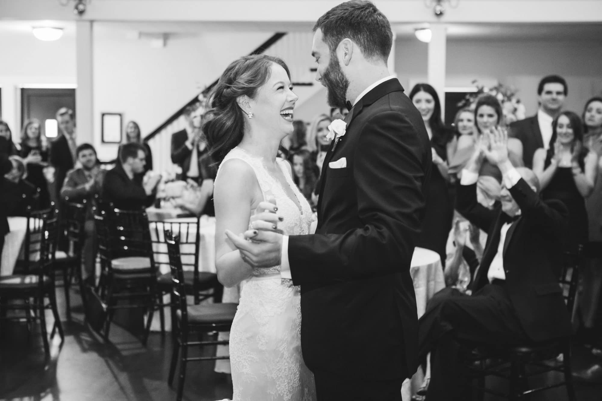 KMD Creations Photography and Film - happy bride and groom sharing their first dance