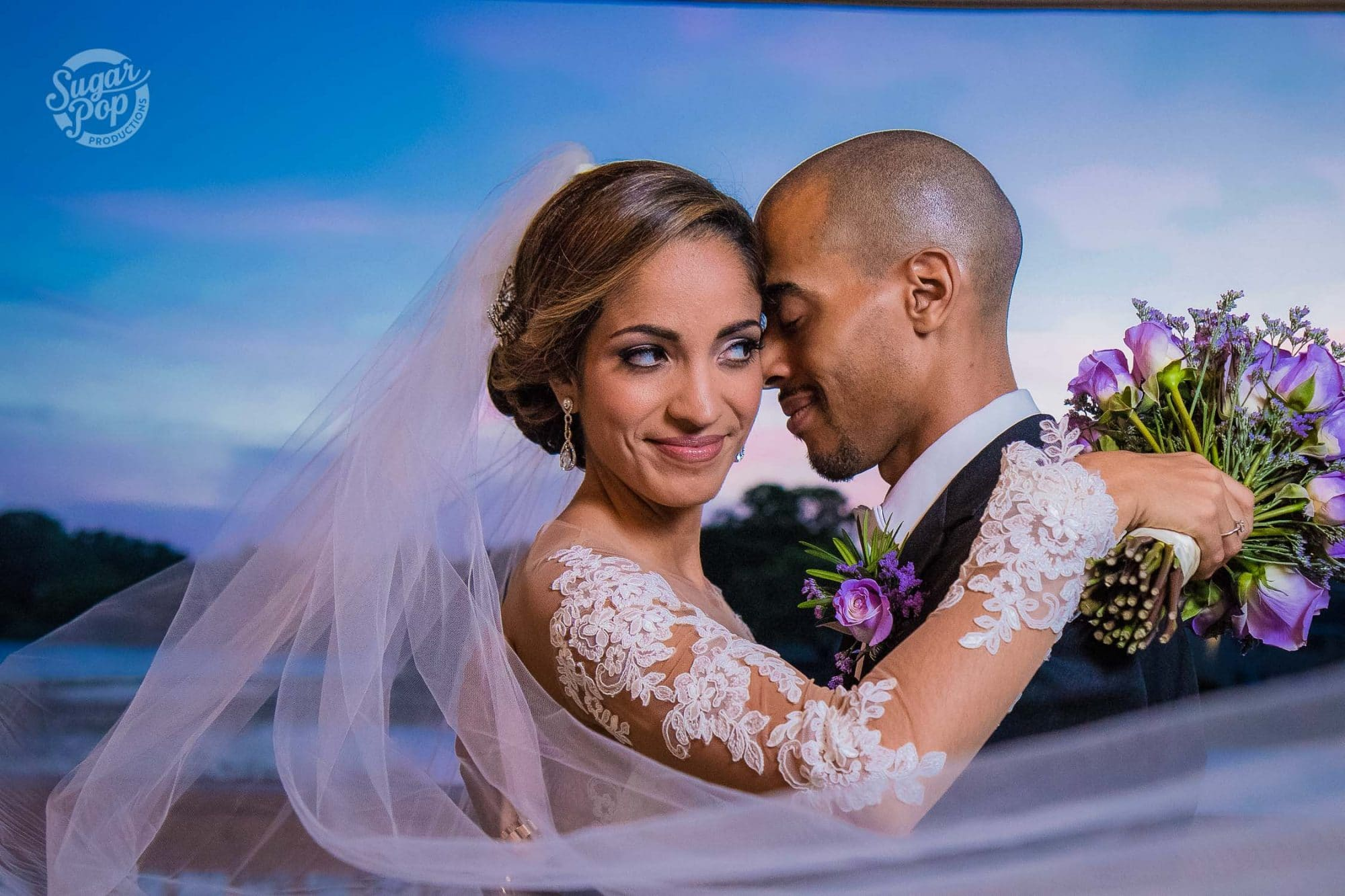 Sugar Pop Productions - bride and groom embracing at sunset