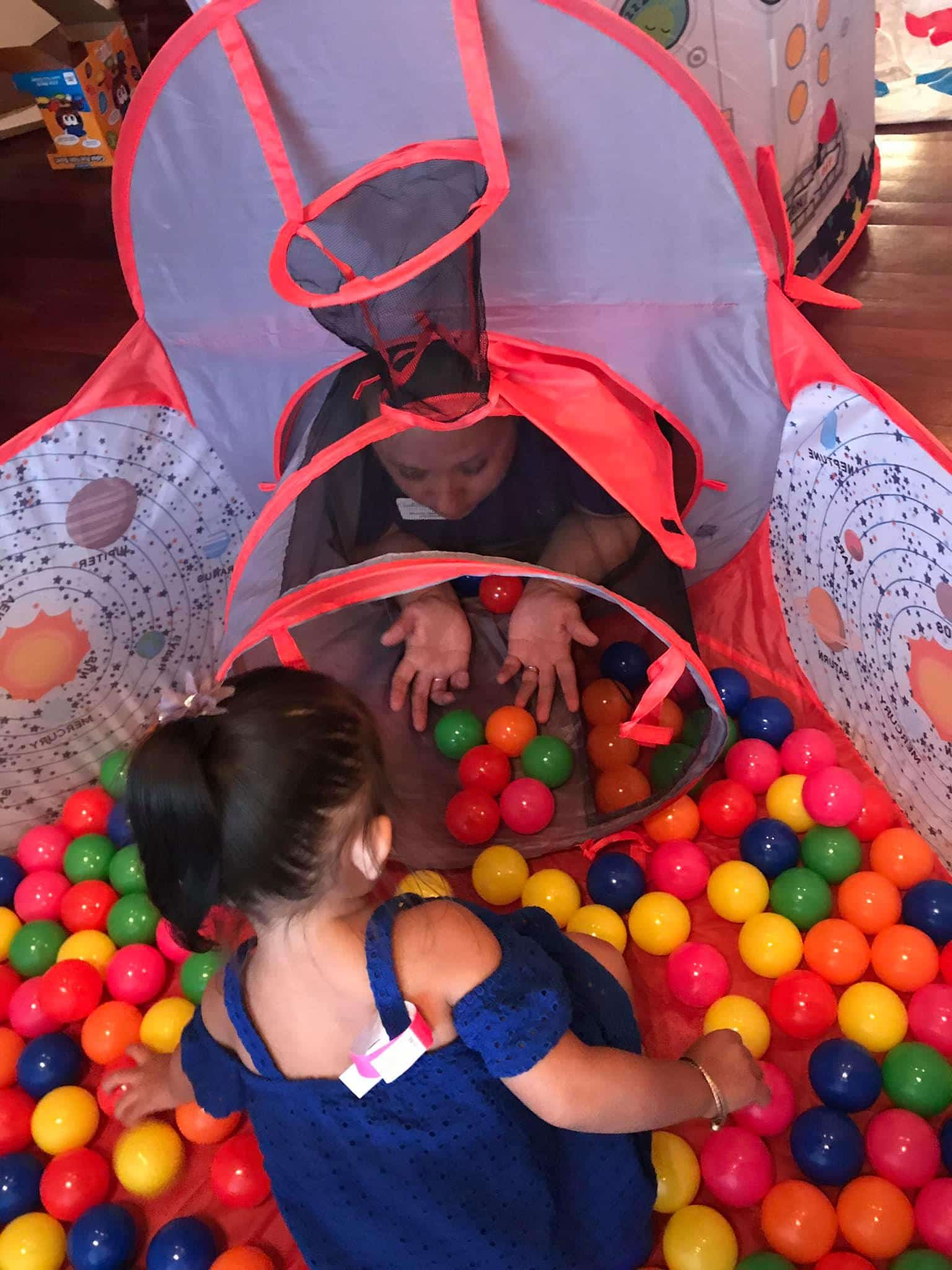 playing in a tube and ball pit