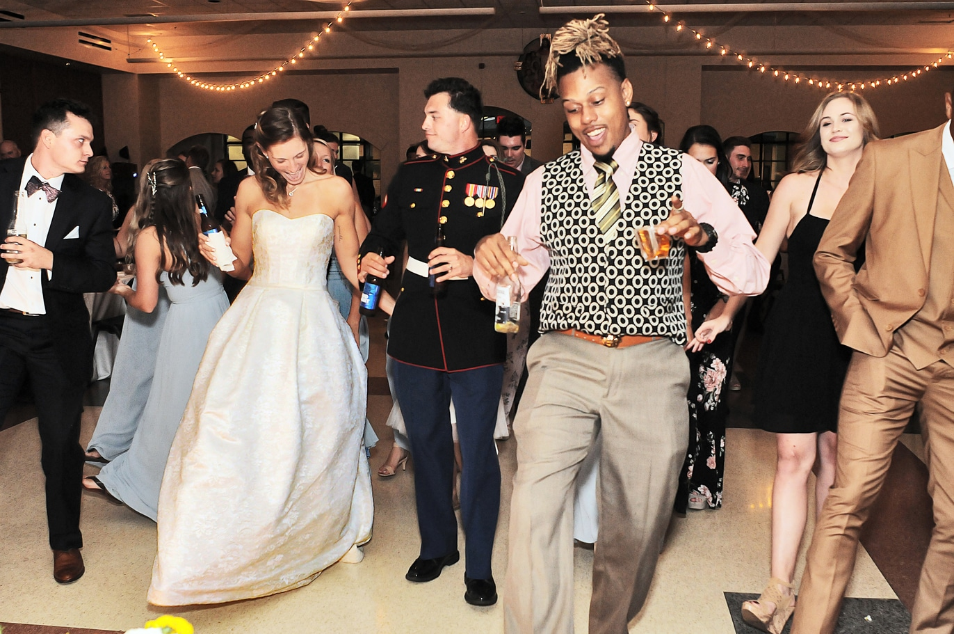 Blue Blazers Entertainment - bride and groom with wedding guests doing line dance