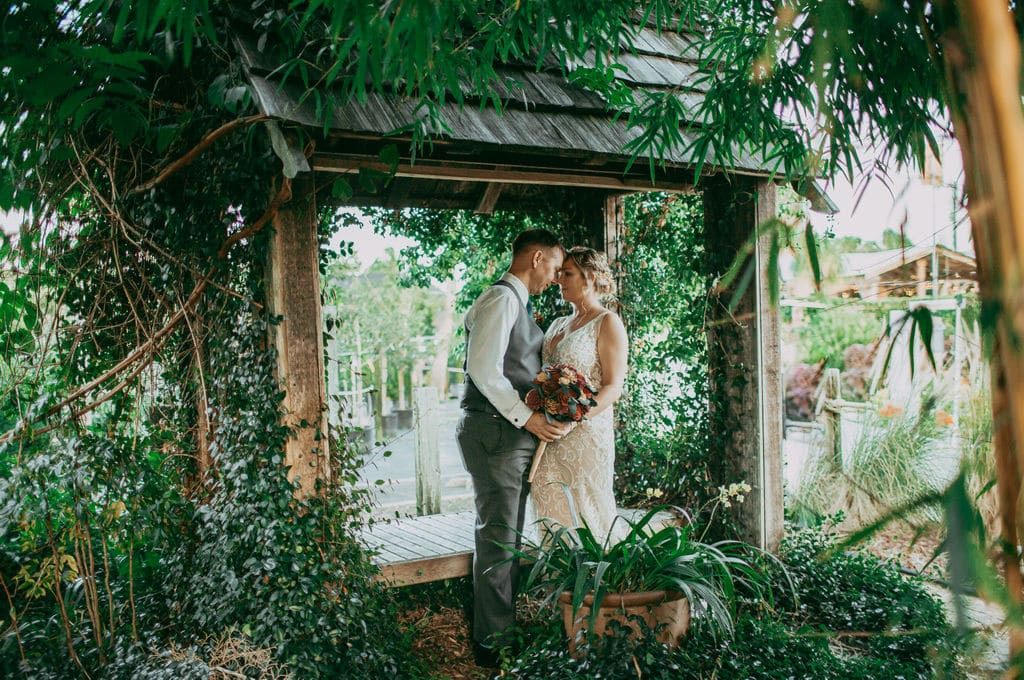 Rockledge Gardens - bride and groom in lush garden under pavilion