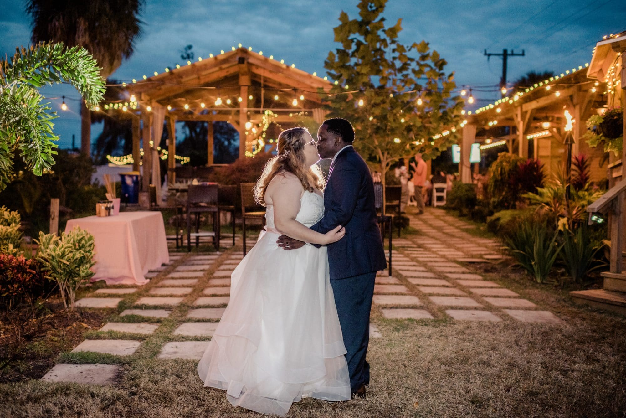 Rockledge Gardens - bride and groom kissing among pavilions strung with market lighting