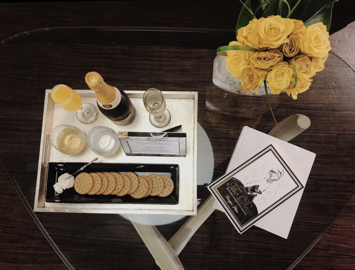 Solutions Bridal - coffee table with tray of cheese, crackers, and mimosas