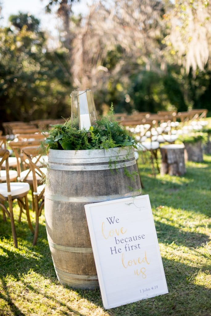 The Magnolia Company - rustic barrel table with unity candle on top for ceremony
