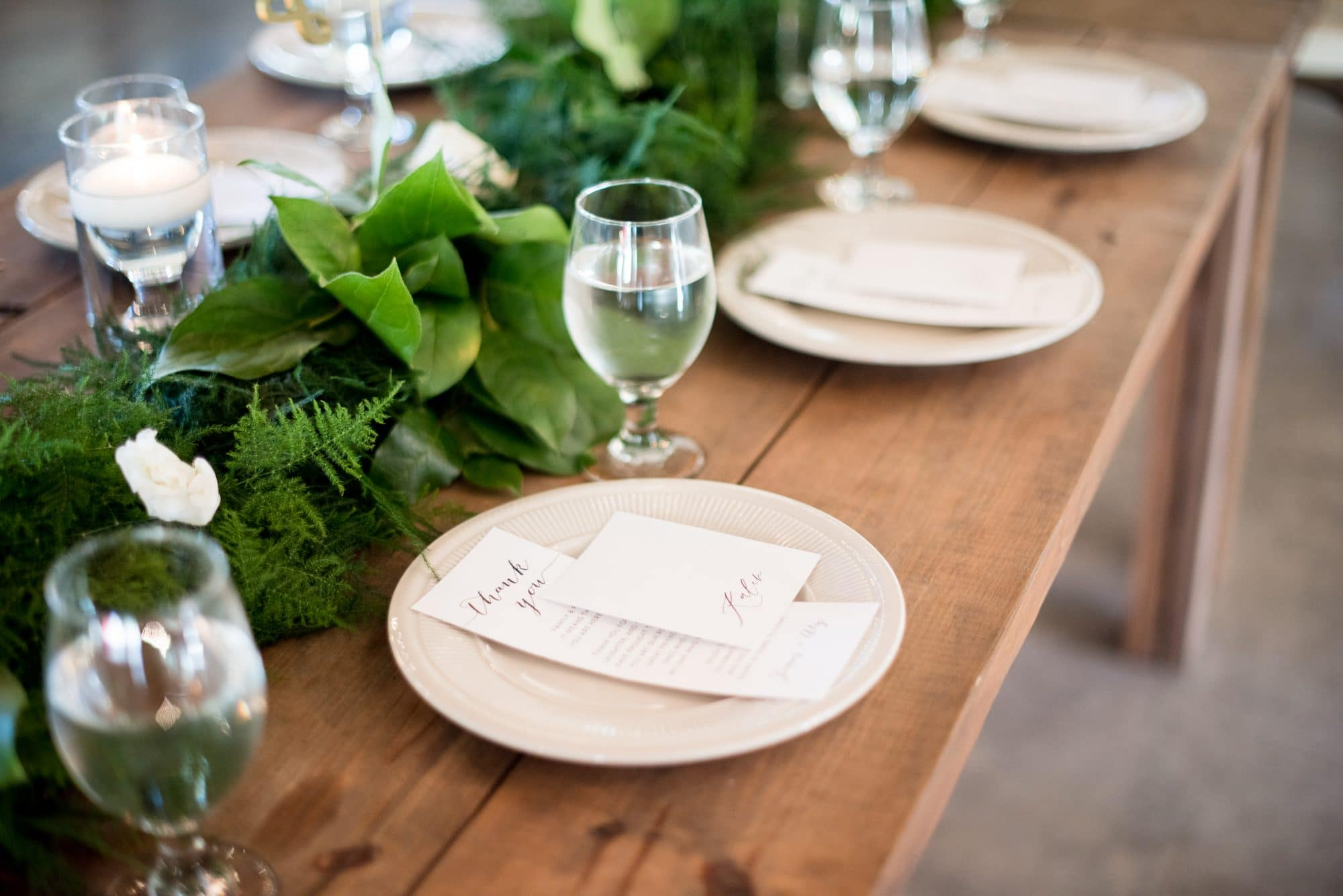 The Magnolia Company - greenery as runner on long rustic table