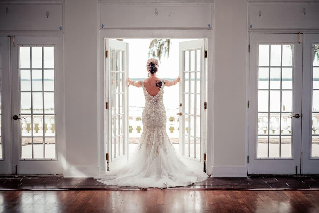 Bella-Cosa-Lakeside-Bride standing in doorway of open french doors