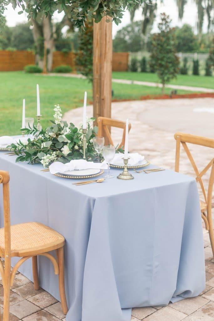 Idlewood Wedding Venue wedding reception table setup outside near pool