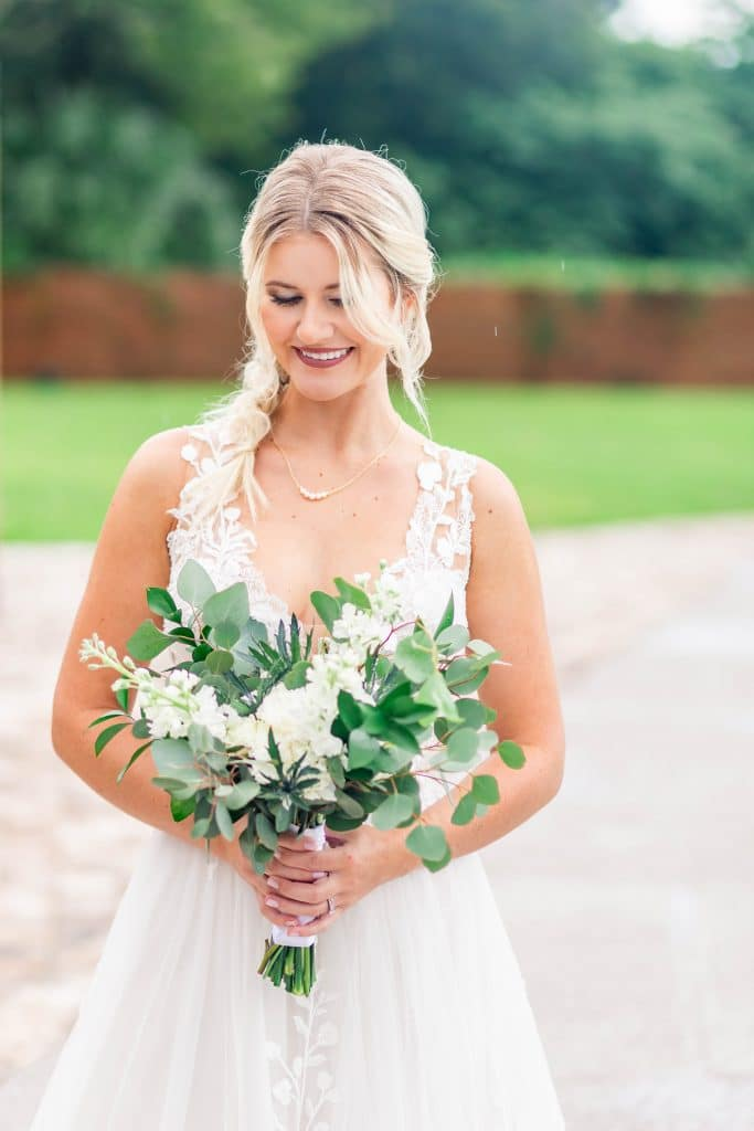 Idlewood Wedding Venue bride smiling holding bouquet of flowers