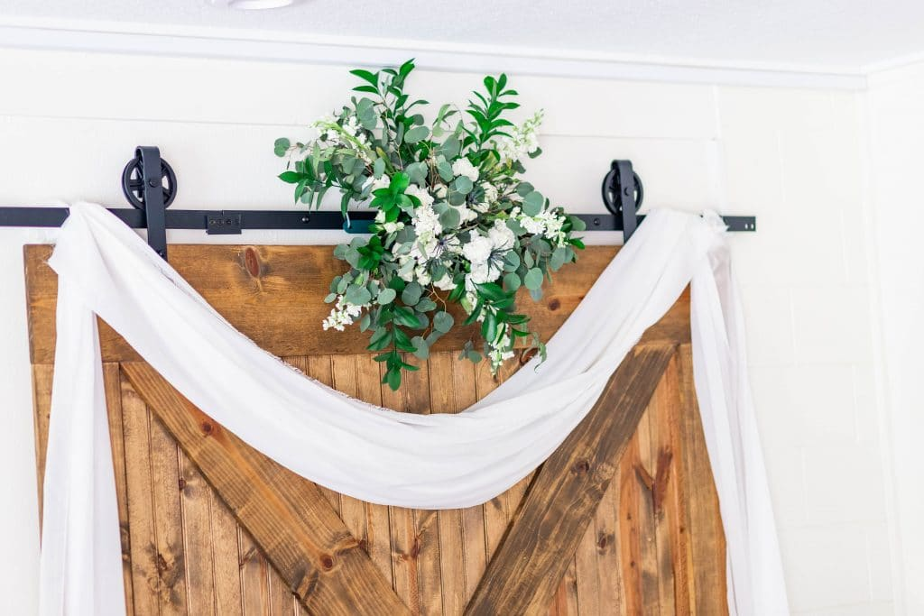 Idlewood Wedding Venue barn door decorated with lace and flowers
