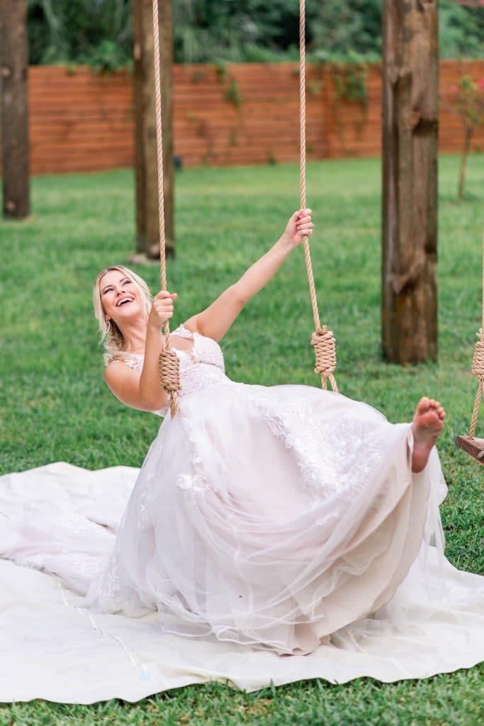Idlewood Wedding Venue bride swinging on rope swing