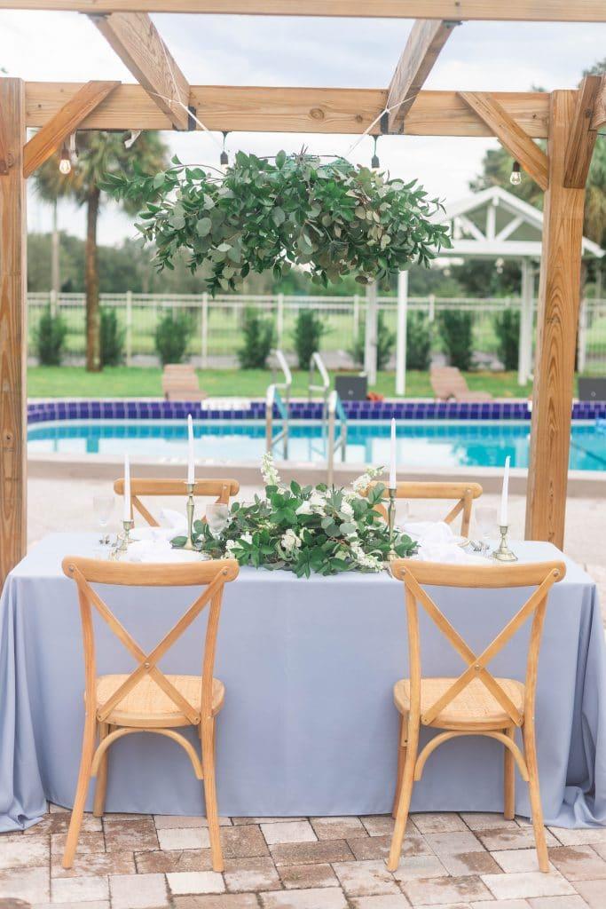 Idlewood Wedding Venue wedding reception tables setup outside overlooking pool