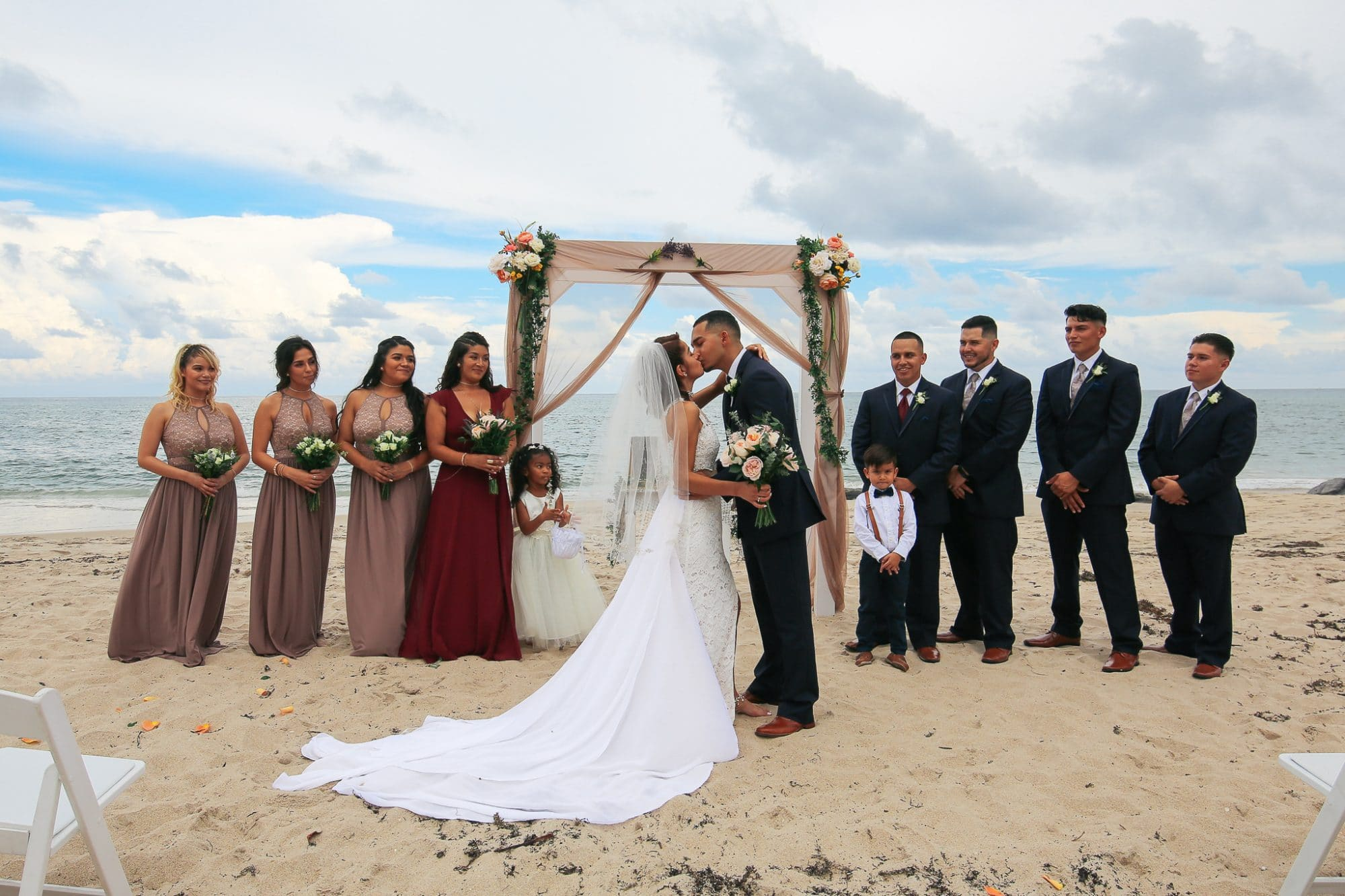 Live Love Laugh Events - bride and groom's first kiss at beach ceremony