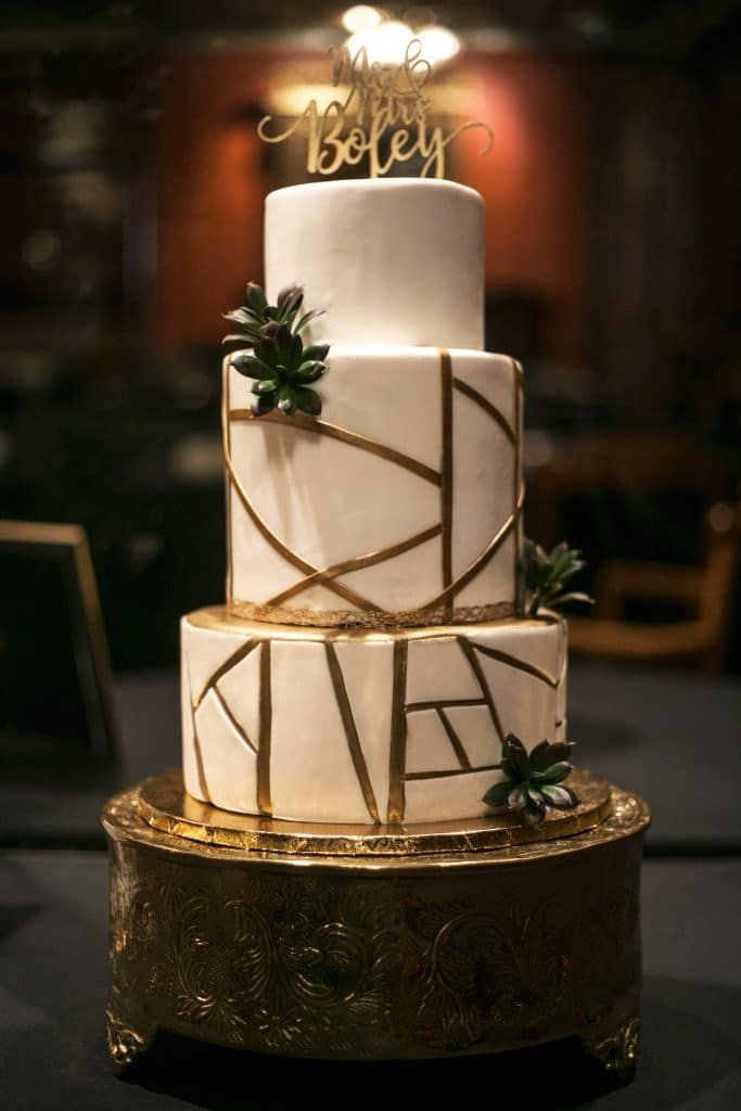 Sofelle Cake Artistry - modern geometric wedding cake with gold accents and succulents