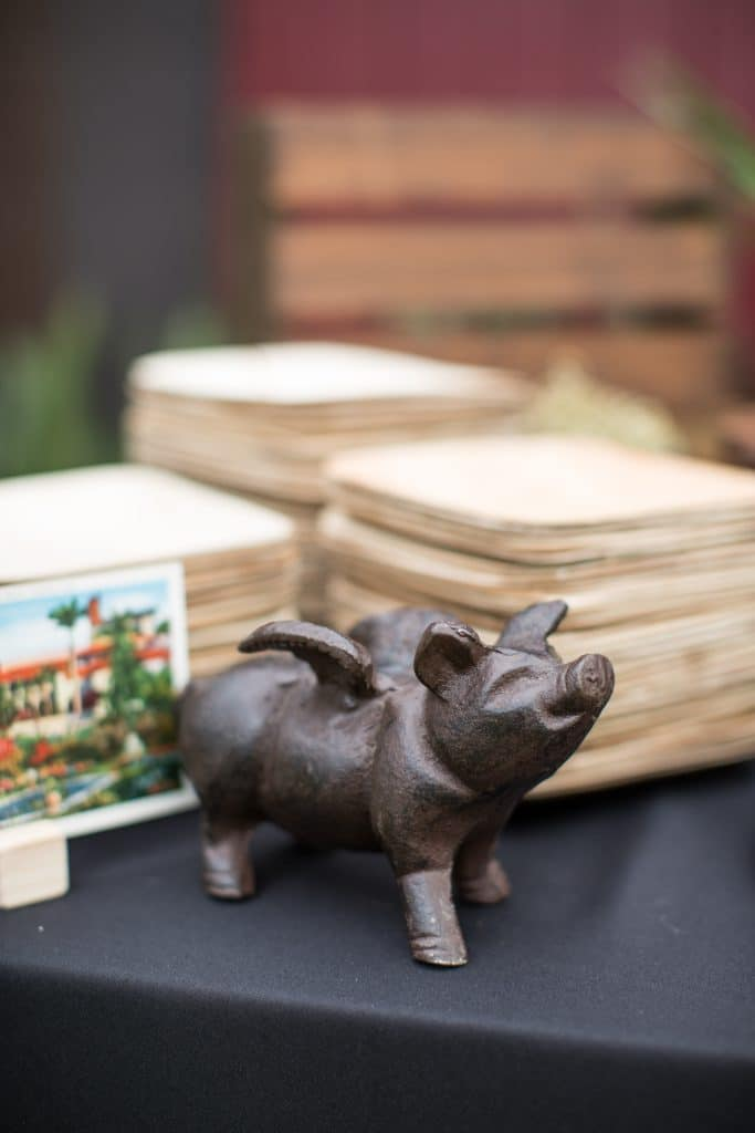 Swine & Sons - small iron pig on buffet table