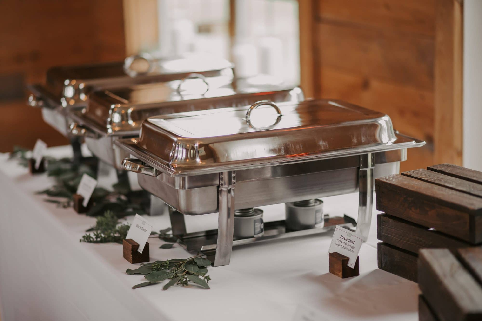 Swine & Sons - chafing dishes set out for wedding reception buffet