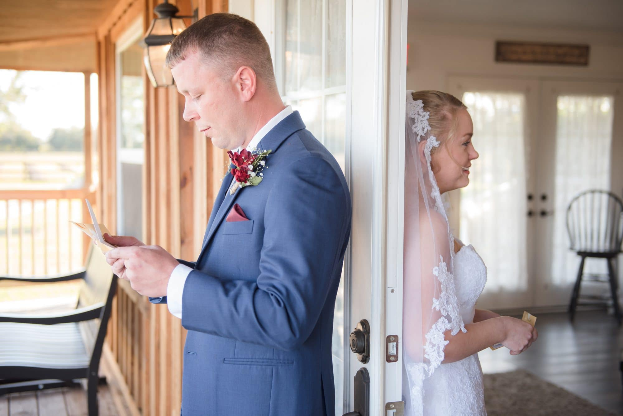 Brittany and Todd reading letters on opposite sides of door.