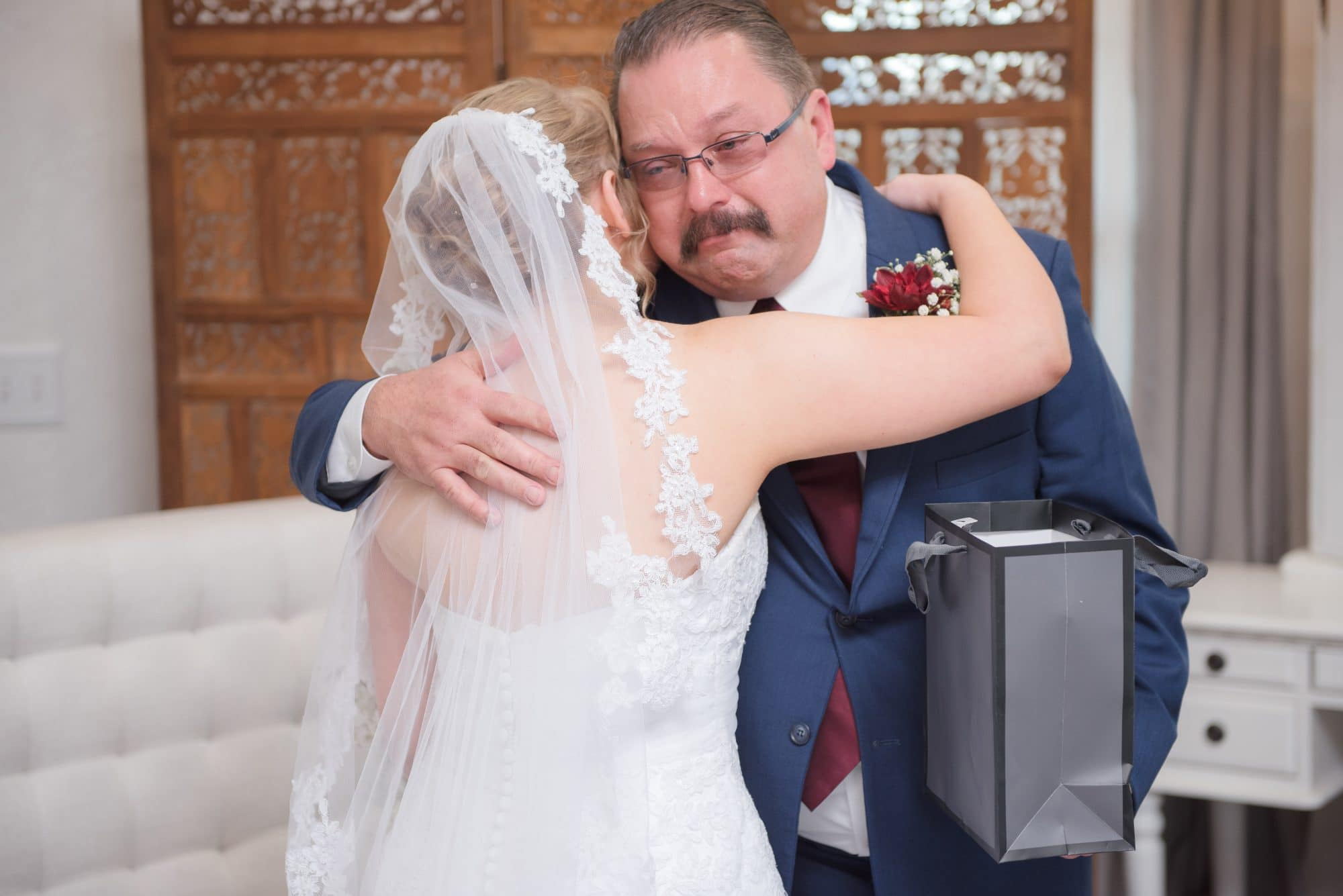 Brittany hugging with emotional dad
