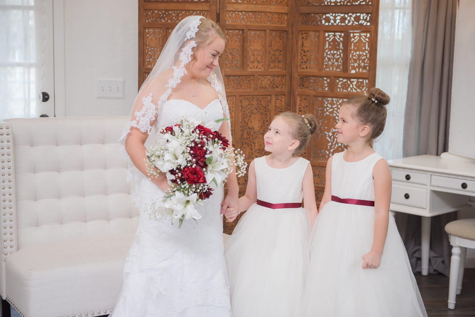 Brittany in getting ready room with her flower girls.
