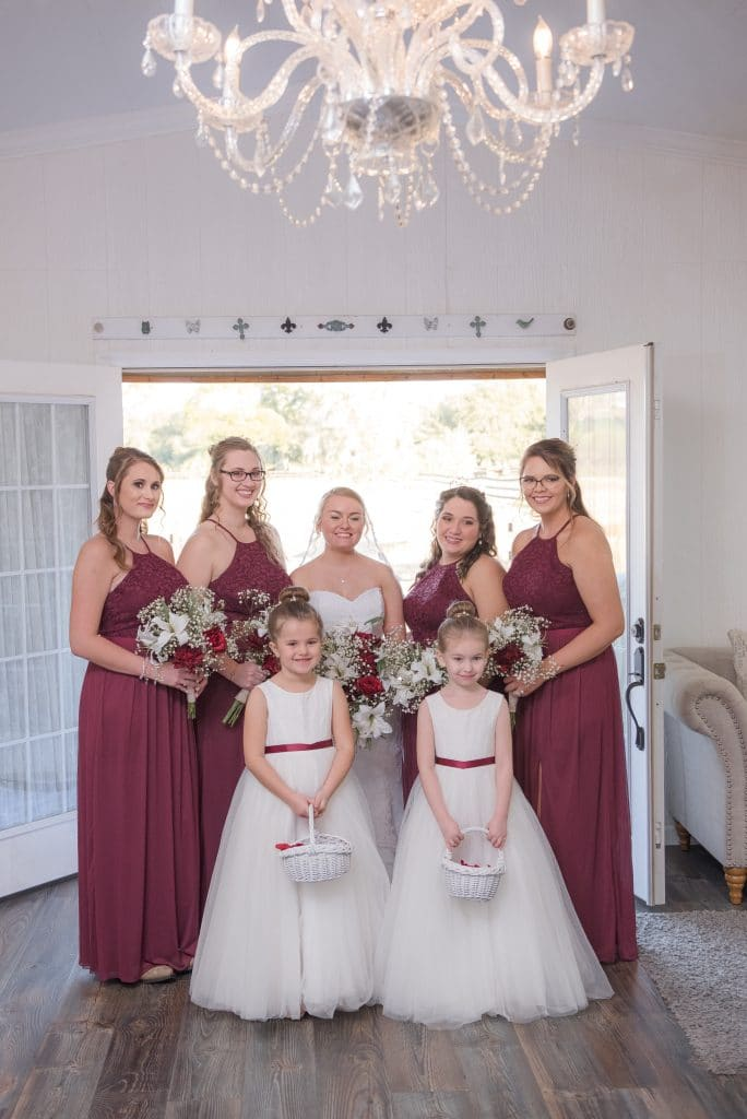 Brittany with bridesmaids and flower girls ready to walk down the aisle.