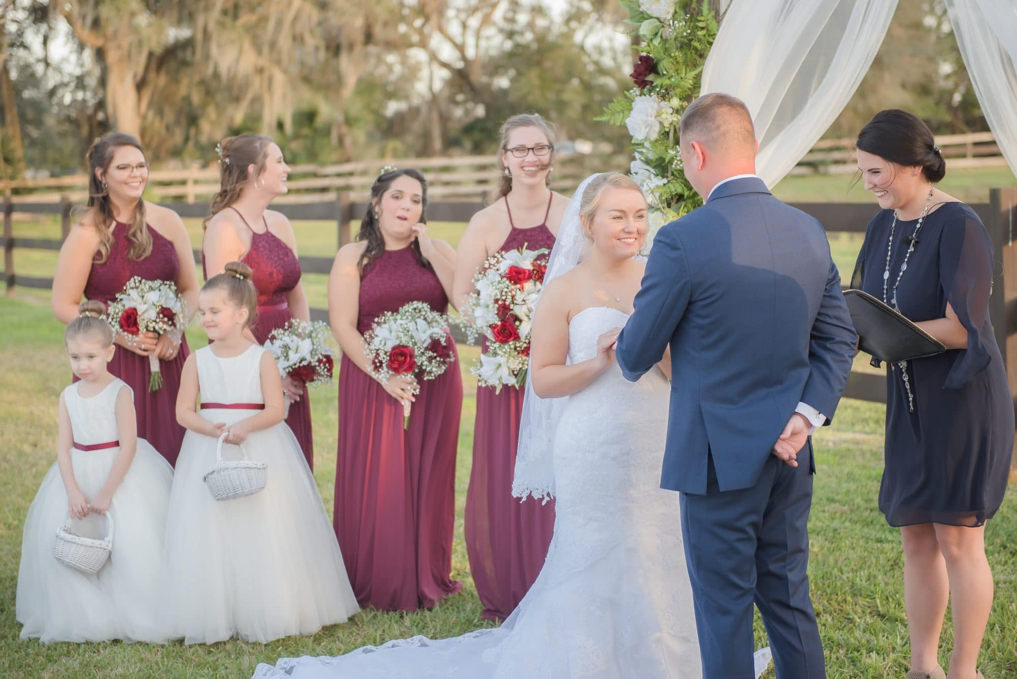 Brittany and Todd saying their vows in beautiful outdoor ceremony