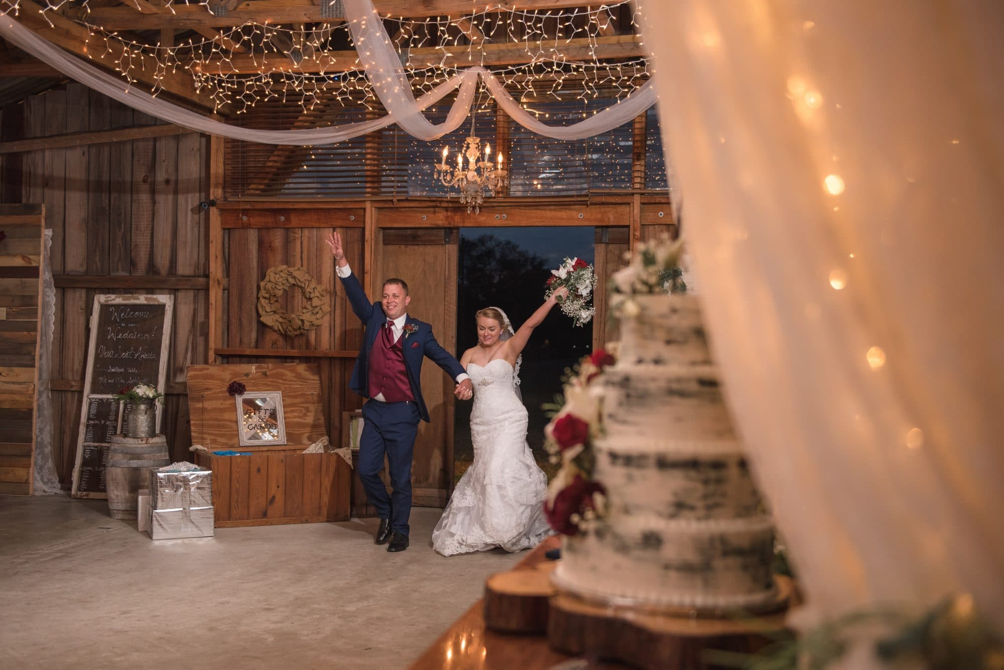Brittany and Todd's grand entrance into their beautiful barn reception hall
