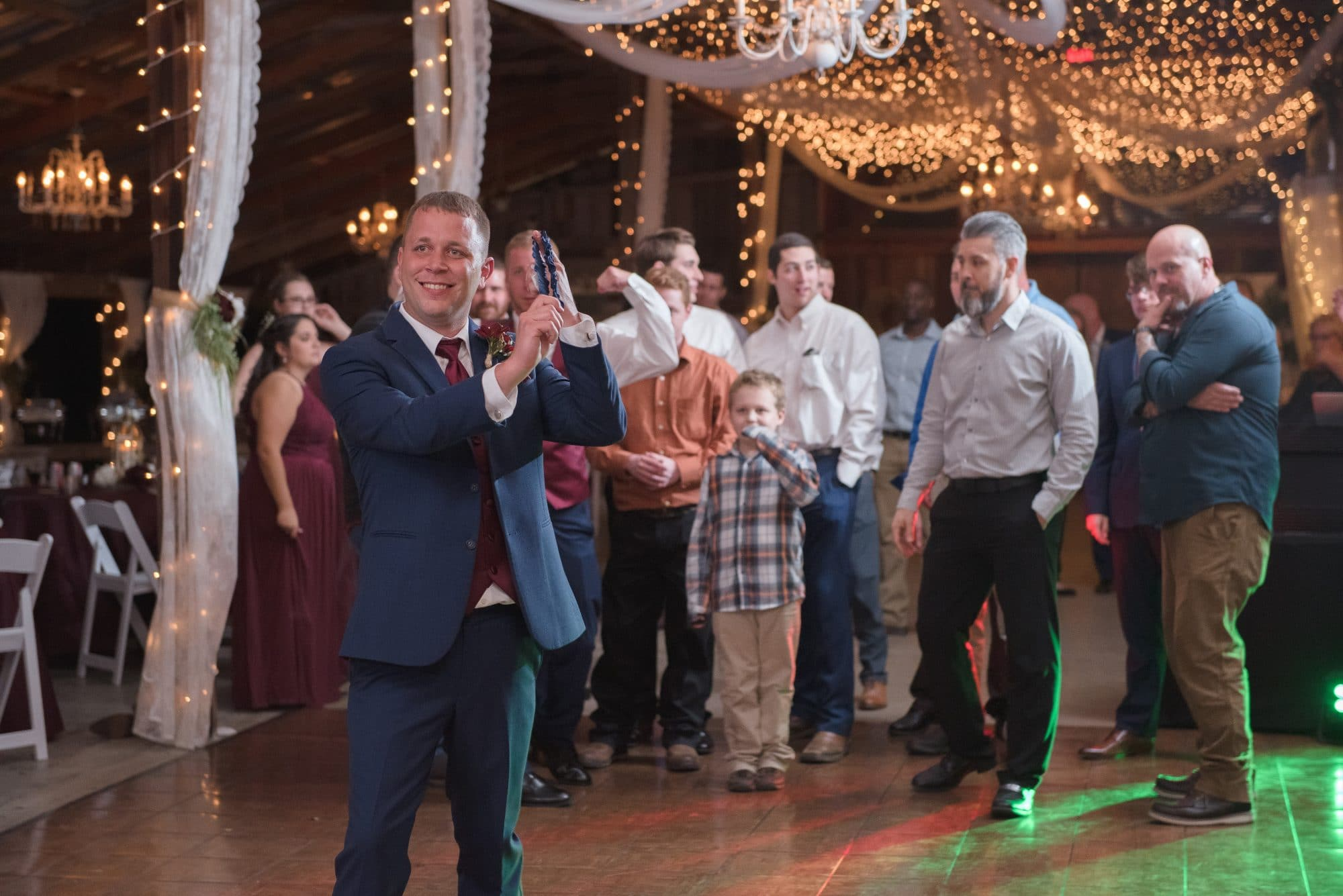 Todd about to throw the garter.