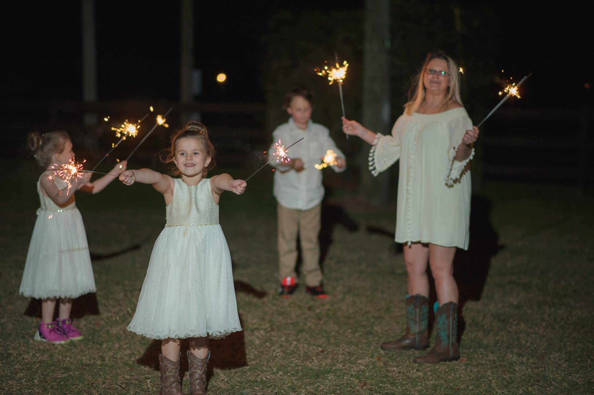children with sparklers at the end of the night.