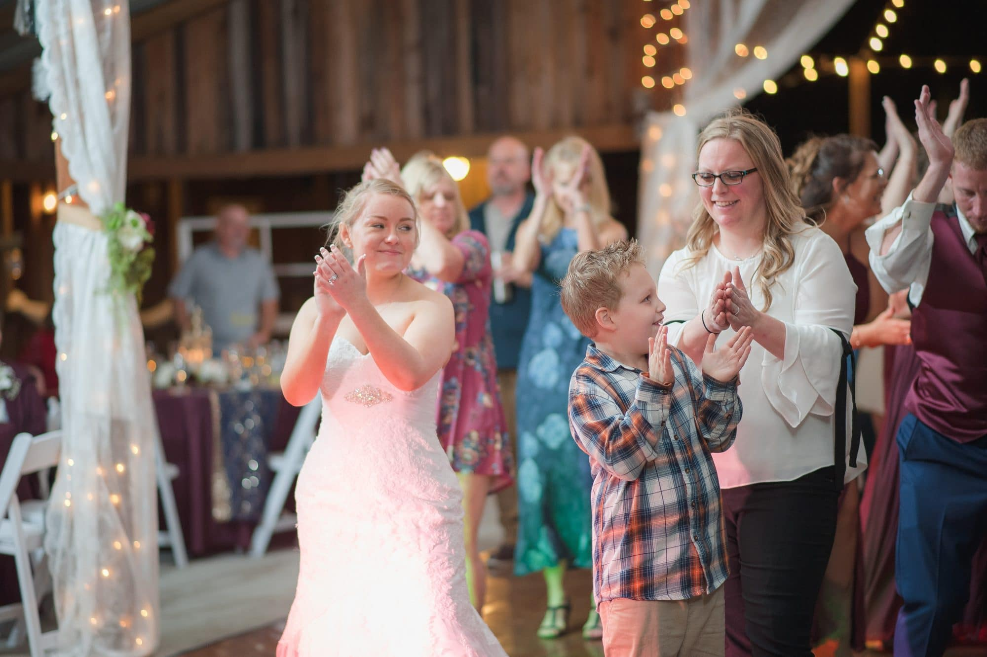 Brittany on dance floor with guests.