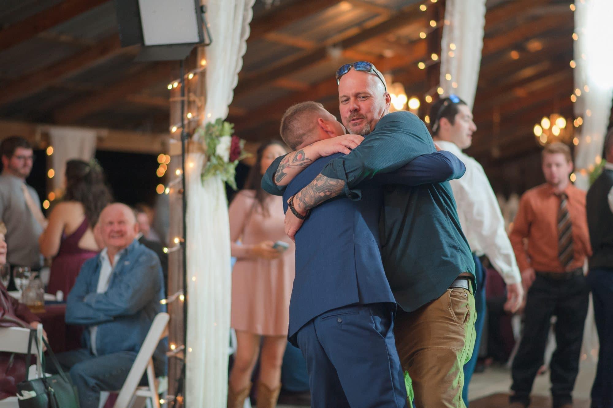 Todd hugging wedding guest.