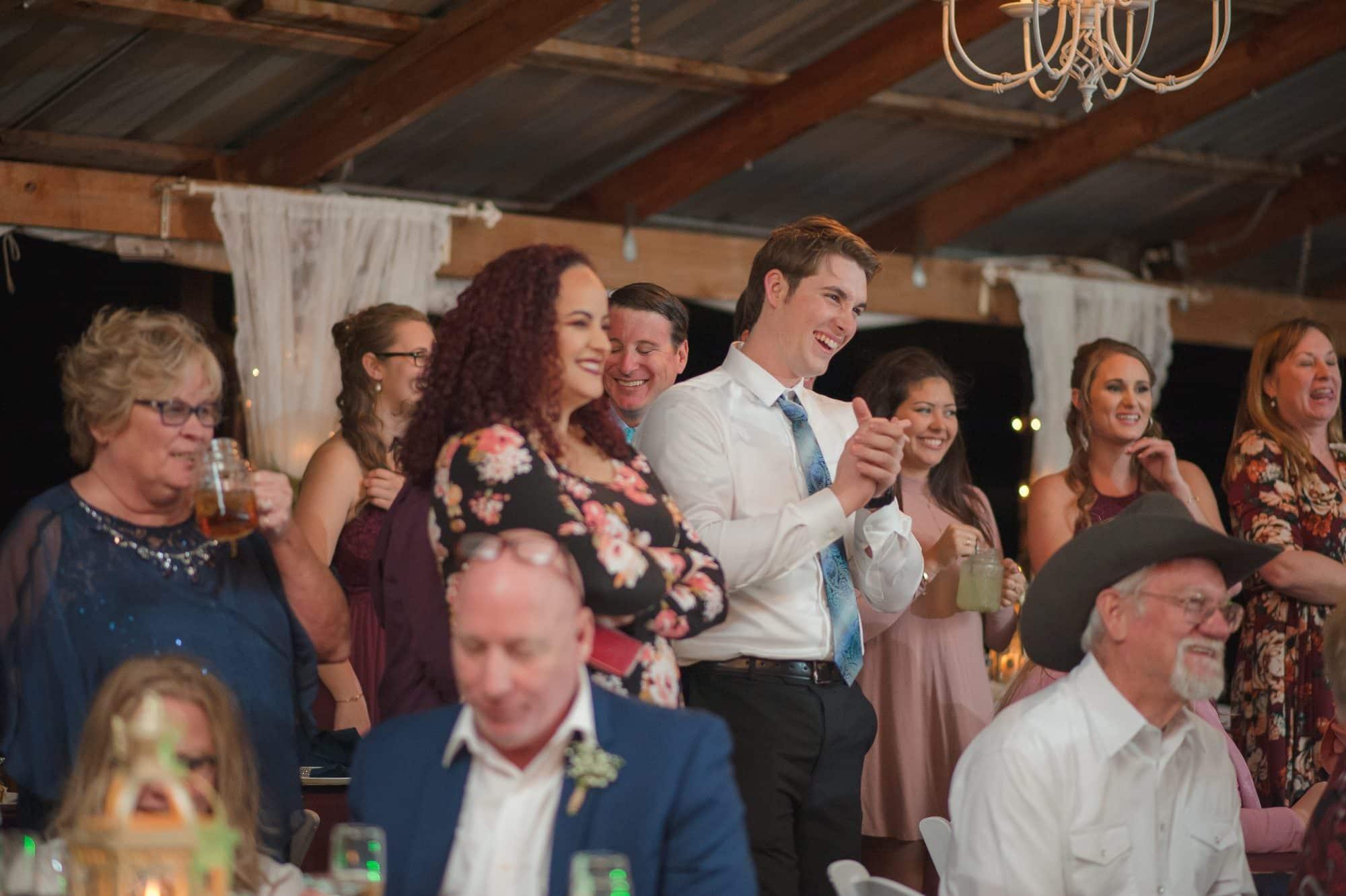 wedding guests smiling at dance floor.