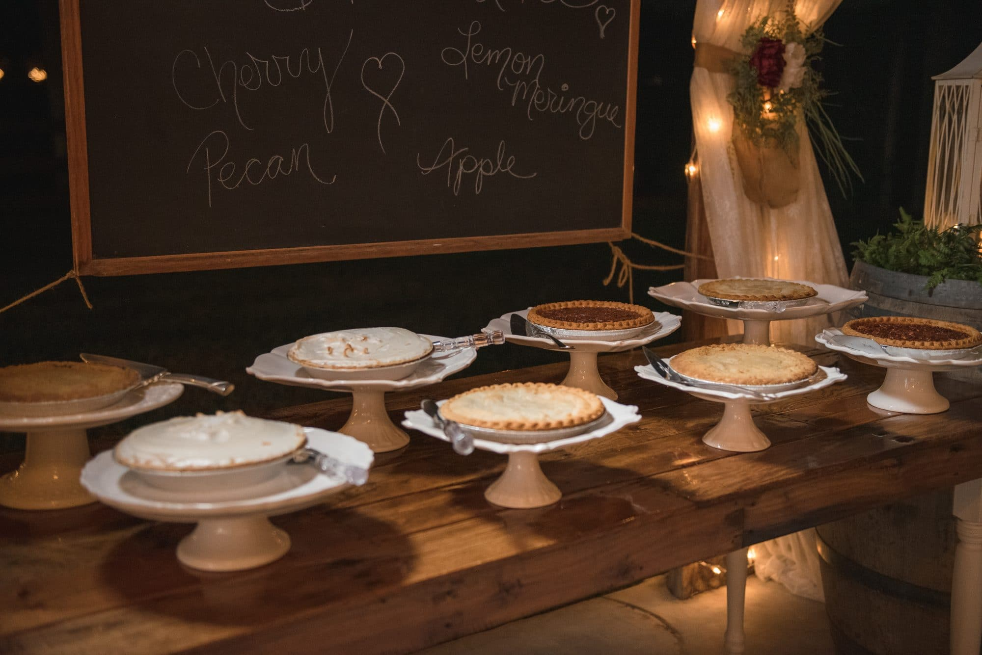Selection of pies on dessert table.