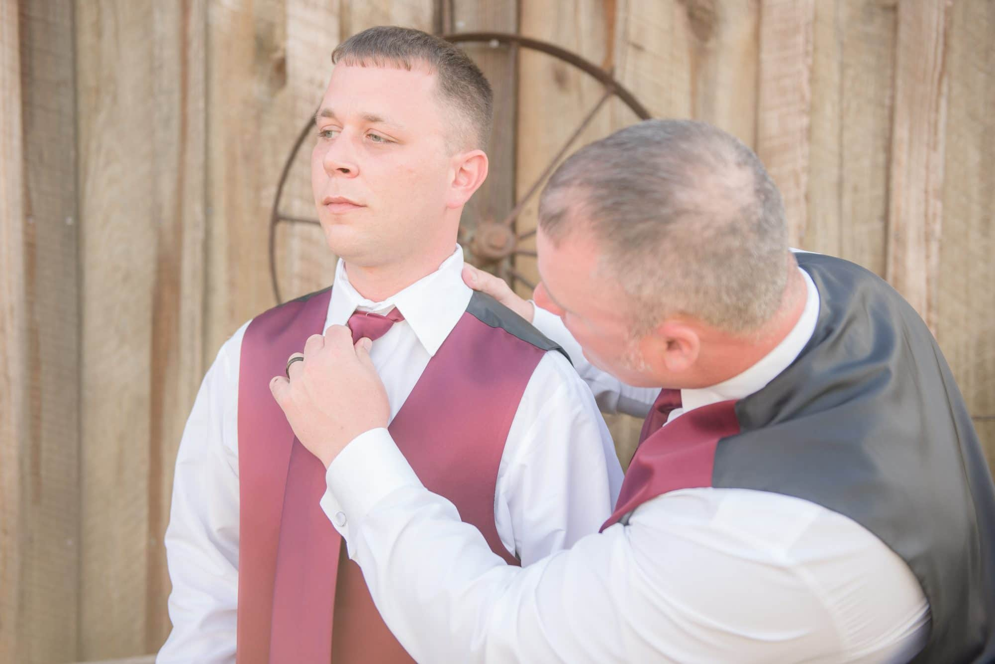 Groom Todd having tie adjusted by father.
