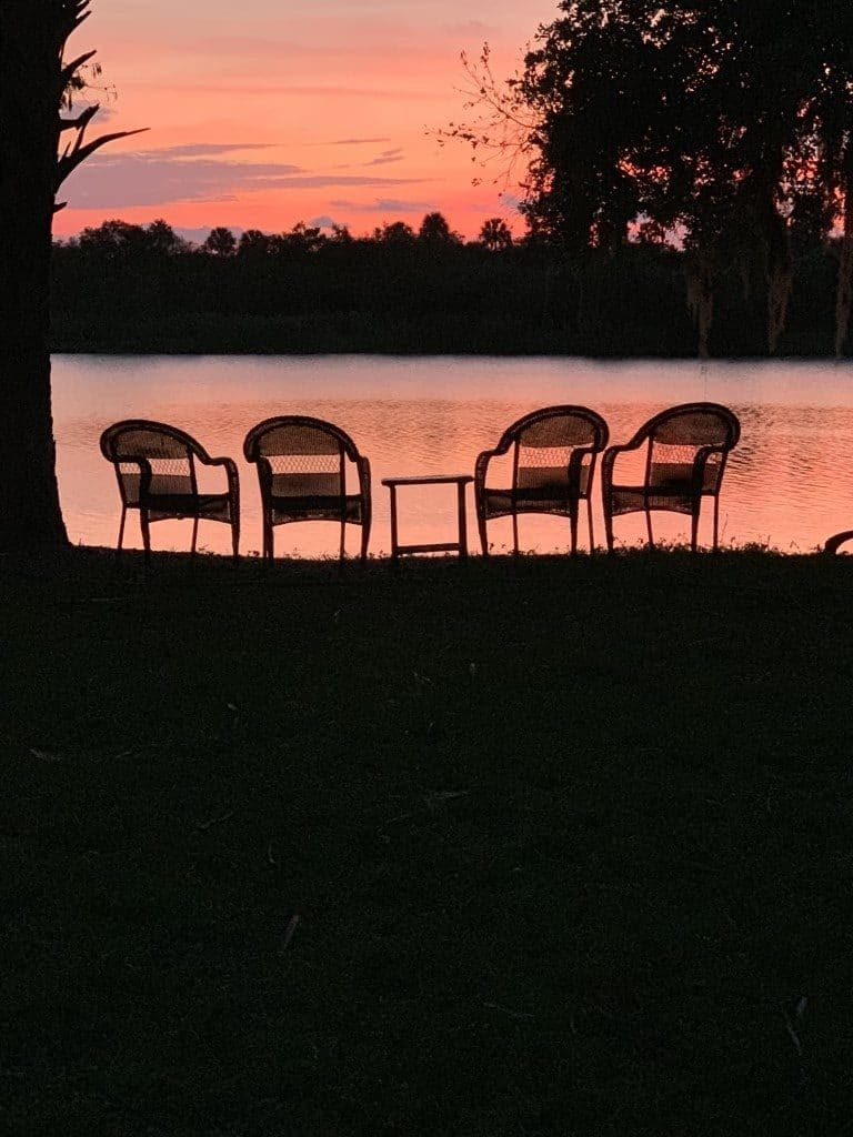Cedar-Knoll-Events-FL-Beautiful pink sunset sky with chairs by the lake silhouette